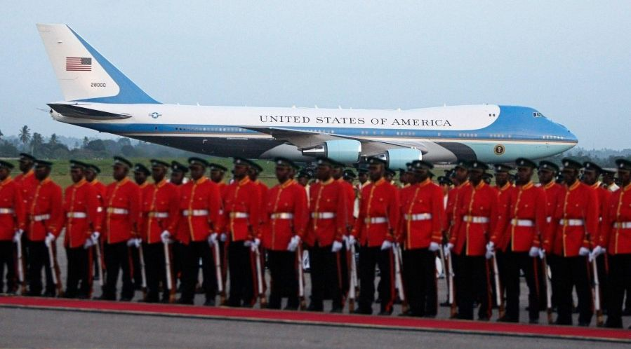 Tanzanian military honor guard waiting on tarmac with Air Force One in background